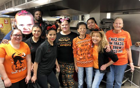 The lunchroom staff gathers together to celebrate the night of October 31, Halloween.